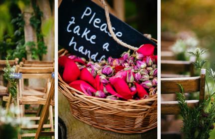 garden wedding details: wooden chairs with chalkboard name tags and scottish thistles, basket of rose petals and dried flowers