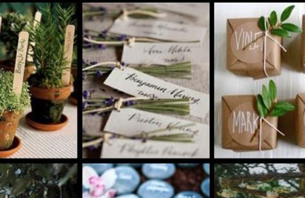 plant pots, brown paper parcels, smooth blue stones and assorted papers with guest names