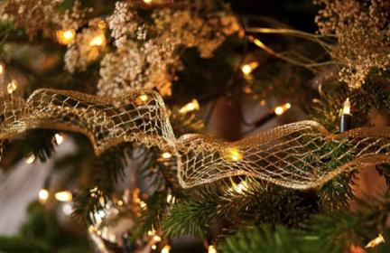 close up christmas wreath with gold baubles and mesh