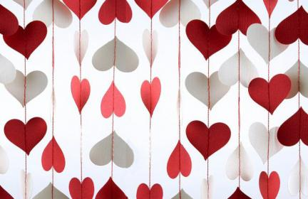 red and white paper cut heart garland