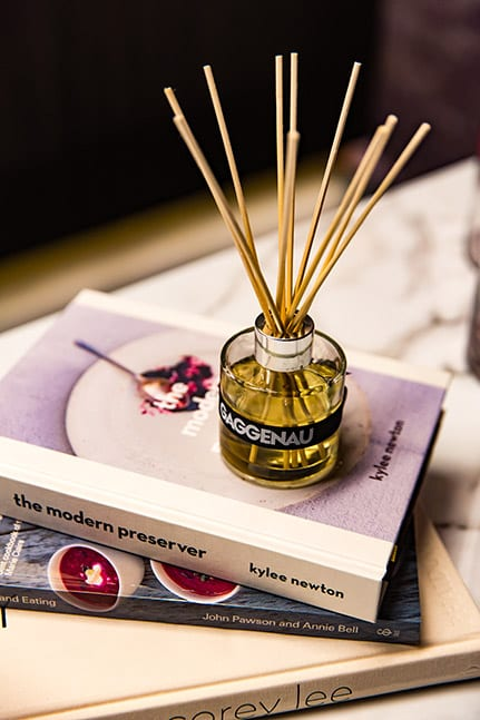 A diffuser on top of a book