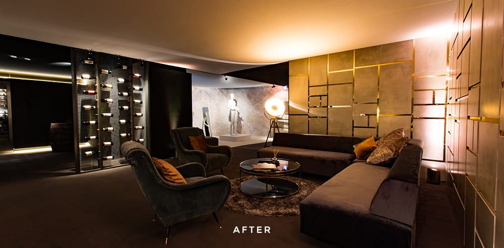 Room with sofa, chairs and mood lighting