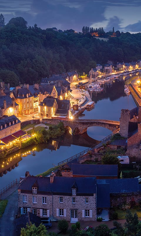 River in France at night surrounded by houses