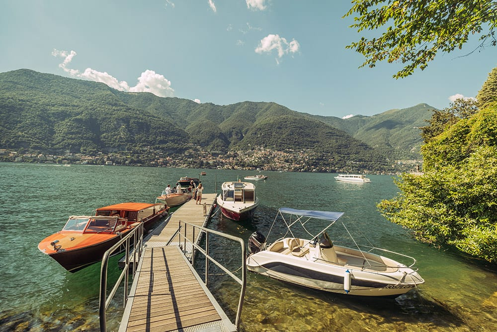 Jetty at Casta Diva with venetian style boats perfect to transport the bridal party to their wedding in Lake Como