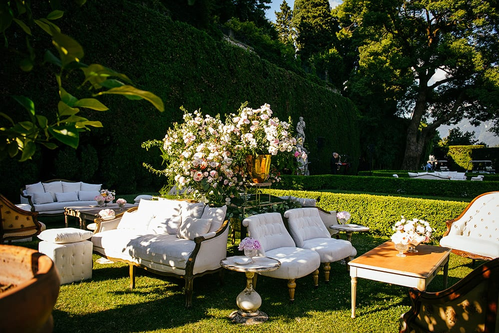 Outdoor seating area decorated with flowers