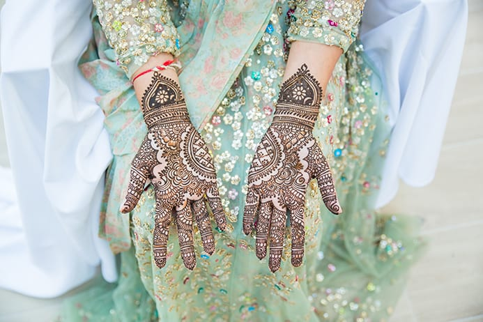 Two hands with henna tattoo