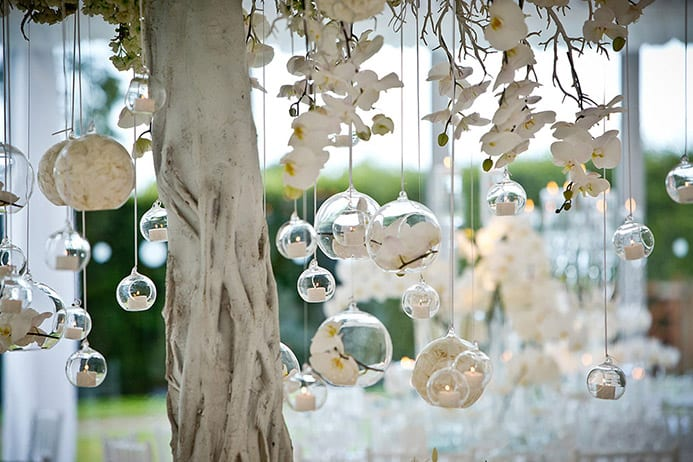 Silver baubles hanging from a decorative tree