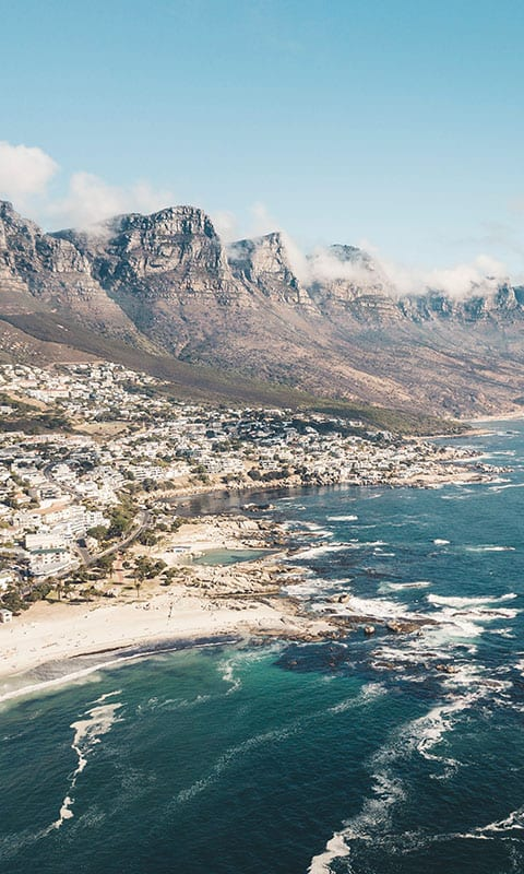 Cliffs overlooking a town and the ocean in South Africa