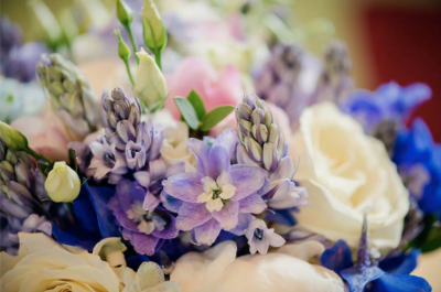 Pretty countryside wedding with a beautiful bridal bouquet for a high end wedding