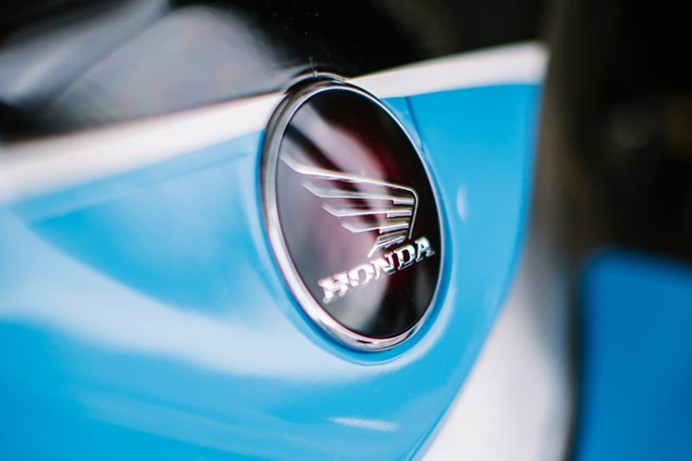 Detail of the Honda badge on the LCR Honda motorbike of Dean Crutchlow