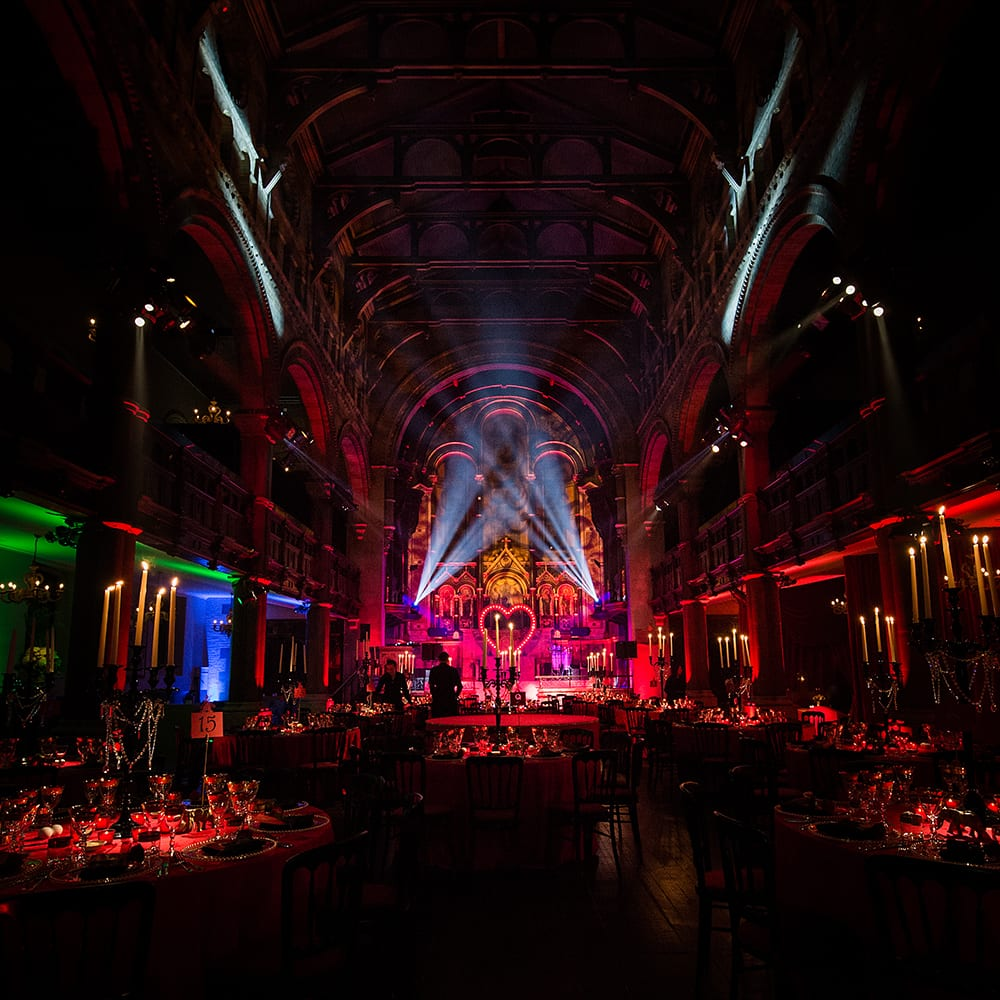 A Moulin Rouge themed birthday party with set design, lighting design and table set up, in a London venue