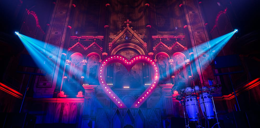 Large illuminated heart installation inside a private birthday party at a London venue for a Moulin Rouge themed event