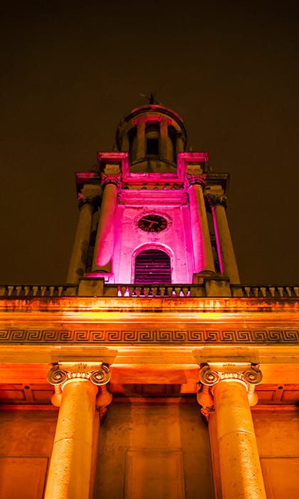 Luxurious wedding venue One Marylebone at night lit up in soft pink and yellow lights