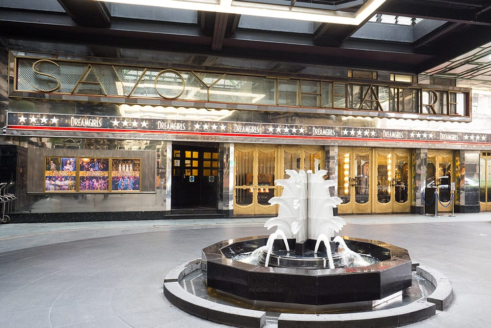 The entrance of the Savoy Theatre in London with water fountain outside