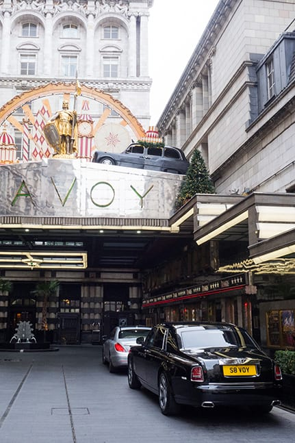 The Savoy Hotel entrance with Rolls Royce and luxury car parked outside