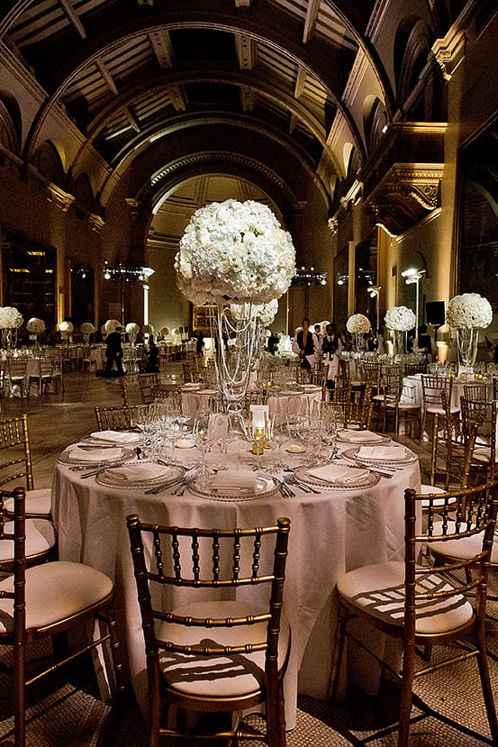 Elegant dinner table prepared for a Nigerian Royal white wedding in the Ralphael Gallery at the Victoria and Albert Museum