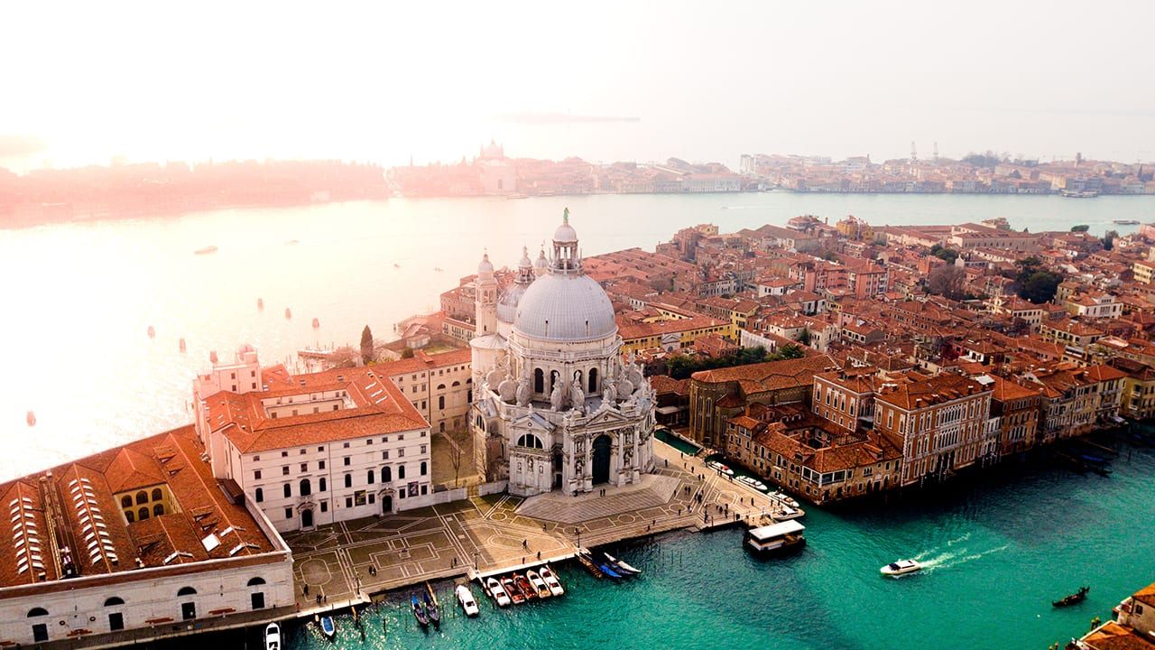 The Santa Maria Della Salute Catholic Church in Venice, Italy, and surrounding buildings for a Venice luxury destination wedding