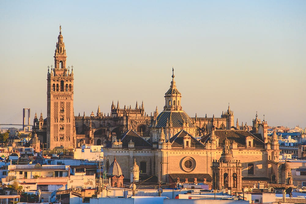 A view of the Seville Cathedral in Spain at sunset for a destination wedding